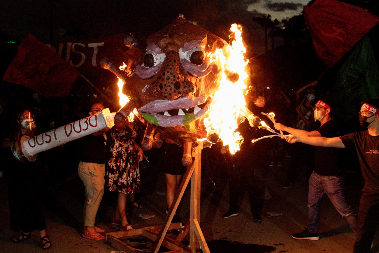 "Activists burn an effigy dubbed ""Duterte Virus"" during a protest in Quezon City, Metro Manila, Philippines on September 21, 2020."