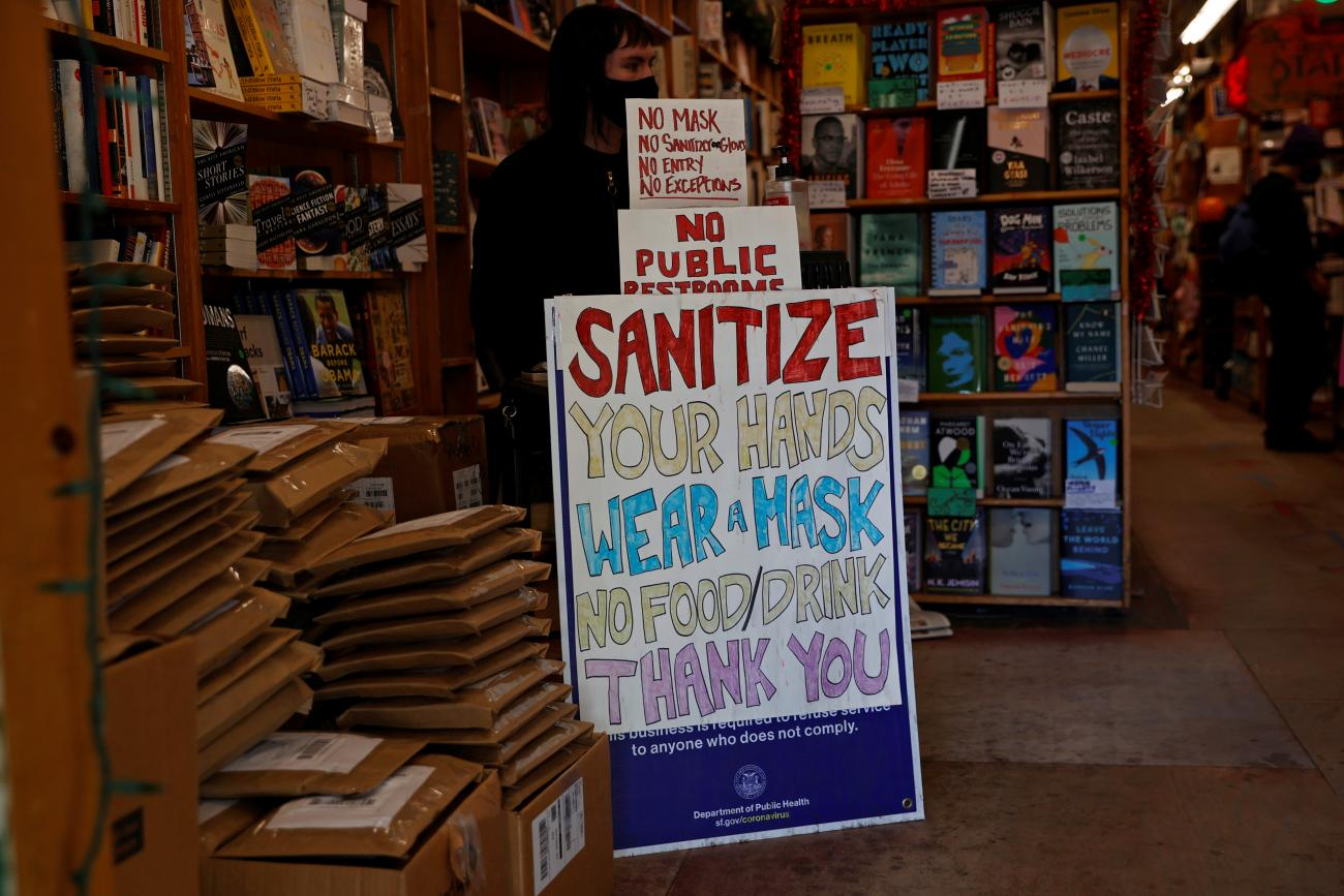 A safety protocol sign is seen at the entrance of a store ahead of the new stay-at-home order in attempts to stem coronavirus spikes in San Francisco, California on December 6, 2020.