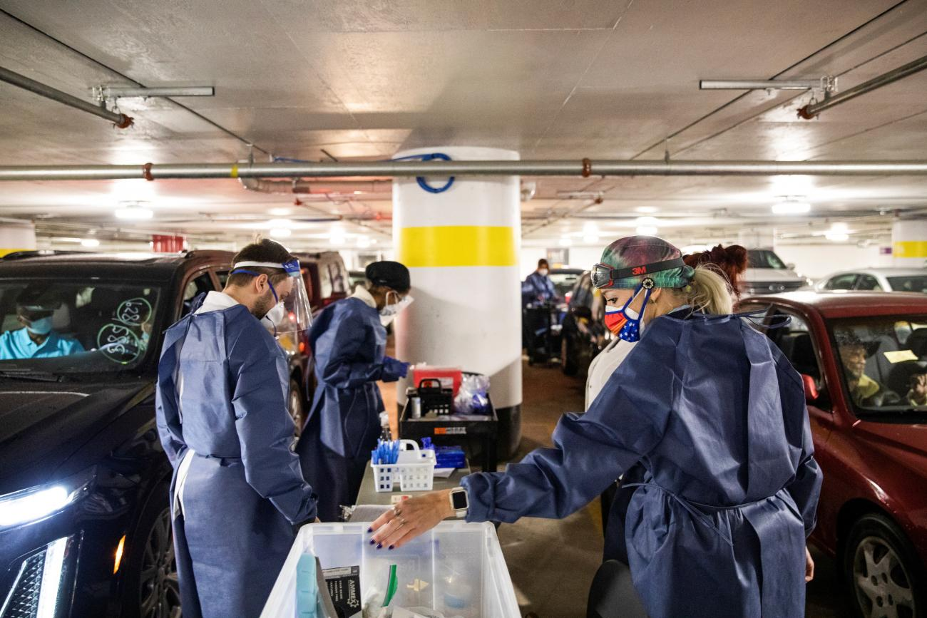 Nurses prepare for the next round of people waiting in their vehicles to receive the coronavirus disease vaccine at a drive through vaccination site in Detroit, Michigan on January 15, 2021