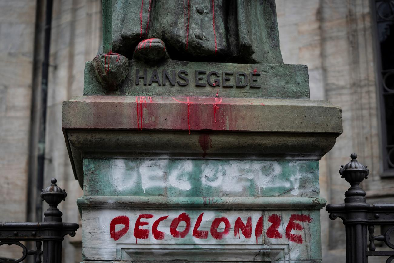 A vandalized statue of the Danish-Norwegian 18th century missionary Hans Egede is seen at the Marble Church (Frederik's Church), in Frederiksstaden, in Copenhagen, Denmark June 30, 2020.