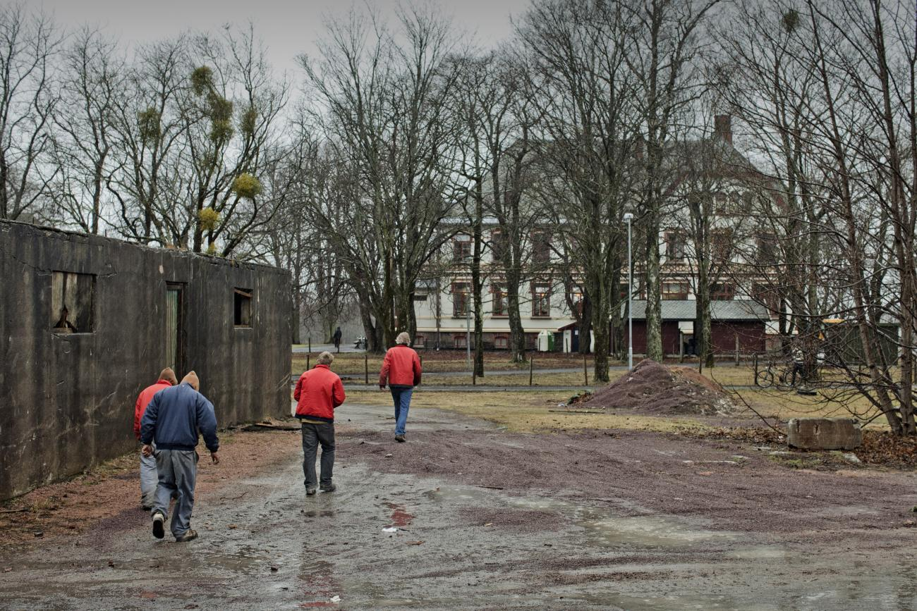Inmates walk away from the shops where the work as they finish their working duties in Bastoy Prison on April 12, 2011 in Bastoy Island, Norway.