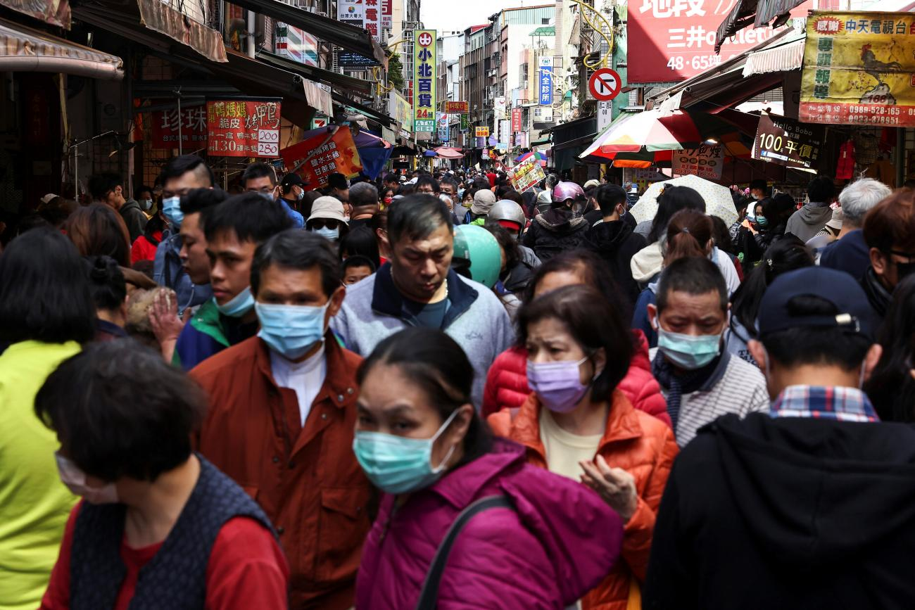 People shop while wearing a protective masks to prevent the spread of coronavirus disease (COVID-19) ahead of the Lunar New Year holiday in Taipei, Taiwan on February 10, 2021.