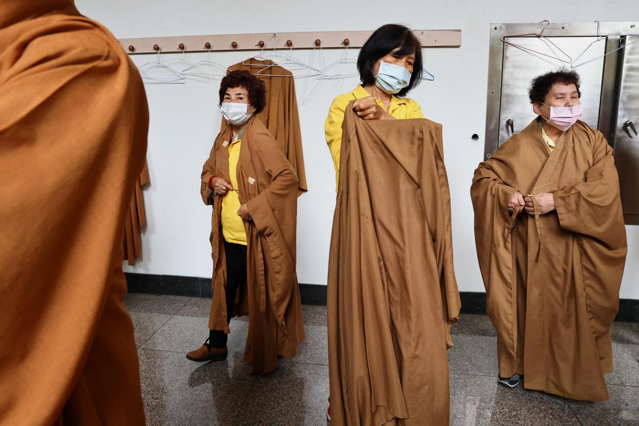 Women wear protective masks to prevent the spread of the coronavirus disease (COVID-19) while preparing for prayer during the Lunar New Year holiday at a temple in Taipei, Taiwan on February 14, 2021.