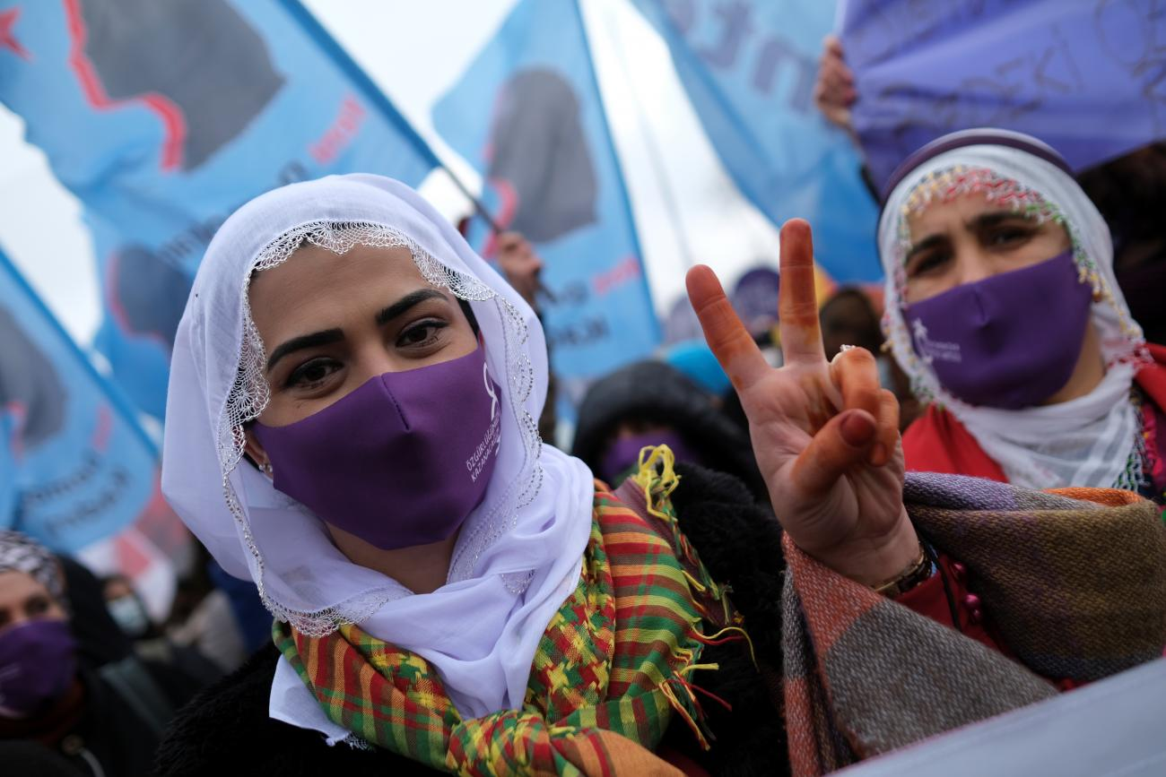 A demonstrator wearing a face mask to prevent the spread of the coronavirus disease (COVID-19) flashes the V sign during a rally ahead of the International Women's Day in Istanbul, Turkey March 6, 2021.