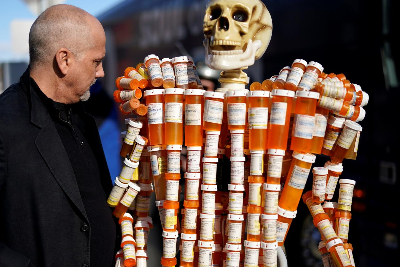 Frank Huntley looks at his sculpture made out of the opioid pill bottles he got when addicted, set up outside Democratic presidential candidate and former Vice President Joe Biden's campaign event in Somersworth, New Hampshire, U.S., February 5, 2020.