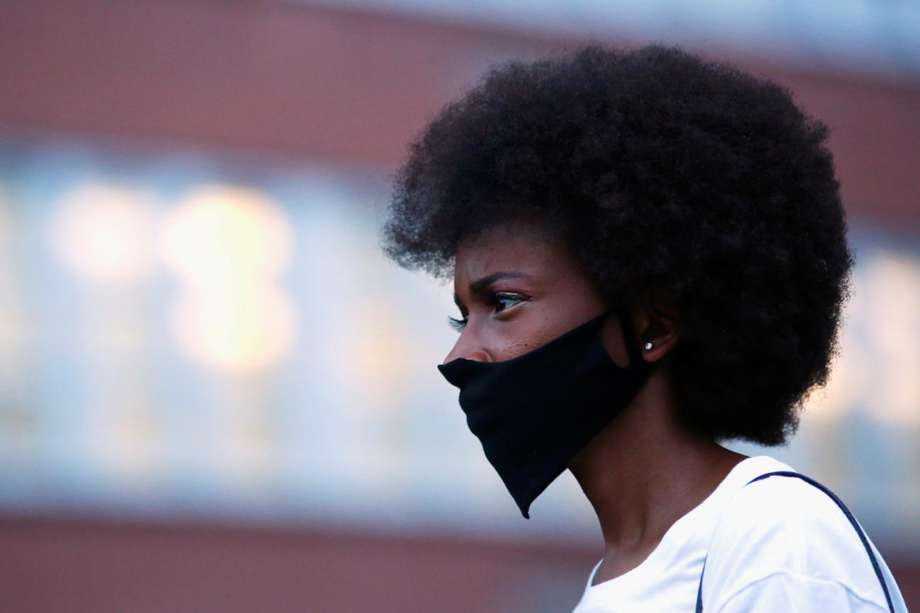 A woman wears a face mask due to the ongoing coronavirus disease in Denver, Colorado on August 24, 2020.
