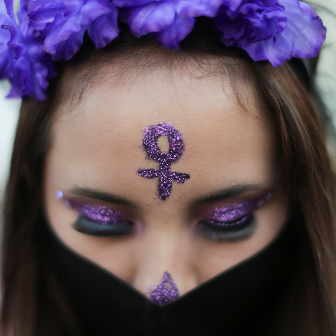 A woman wears a face mask during a protest on the Day of the Dead against gender violence and femicide, in Mexico City, Mexico, November 2, 2020.
