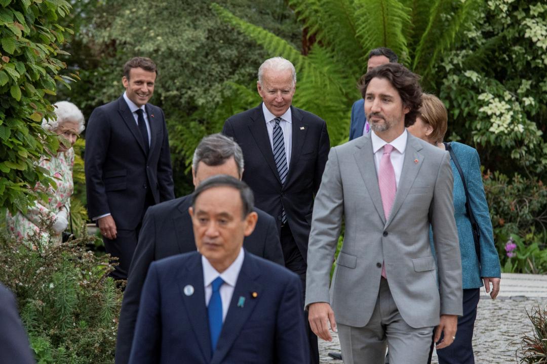 Japan's Prime Minister Yoshihide Suga, Italy's Prime Minister Mario Draghi, Canada's Prime Minister Justin Trudeau, U.S. President Joe Biden, German Chancellor Angela Merkel, France's President Emmanuel Macron, and Britain's Queen Elizabeth at the G7 summit in Cornwall, Britain on June 11, 2021. Jack Hill/Pool via REUTERS