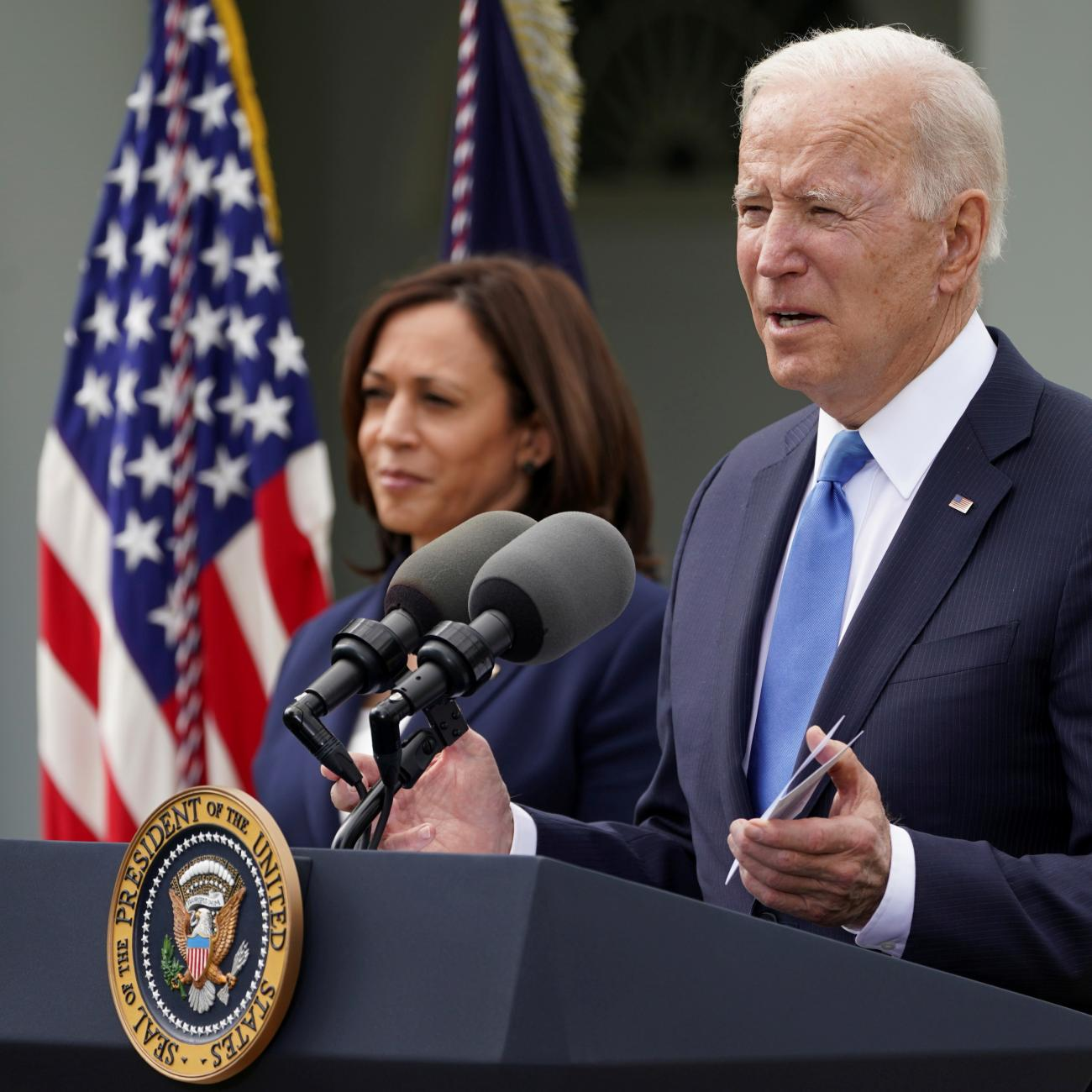 U.S. President Joe Biden, accompanied by Vice President Kamala Harris, speaks about the coronavirus disease (COVID-19) response and the vaccination program from the Rose Garden of the White House in Washington, U.S., May 13, 2021.