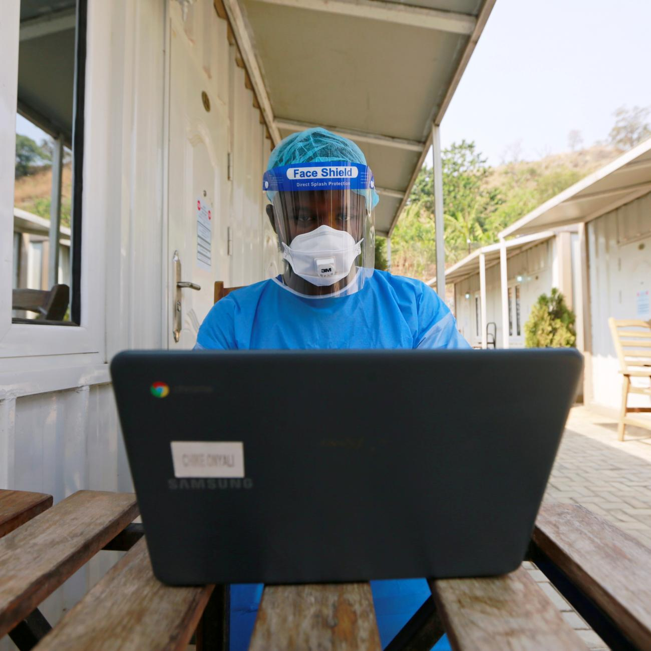 health professional works on a computer at a drive-through sample collection centre for coronavirus disease (COVID-19) in Abuja, Nigeria January 14, 2021.