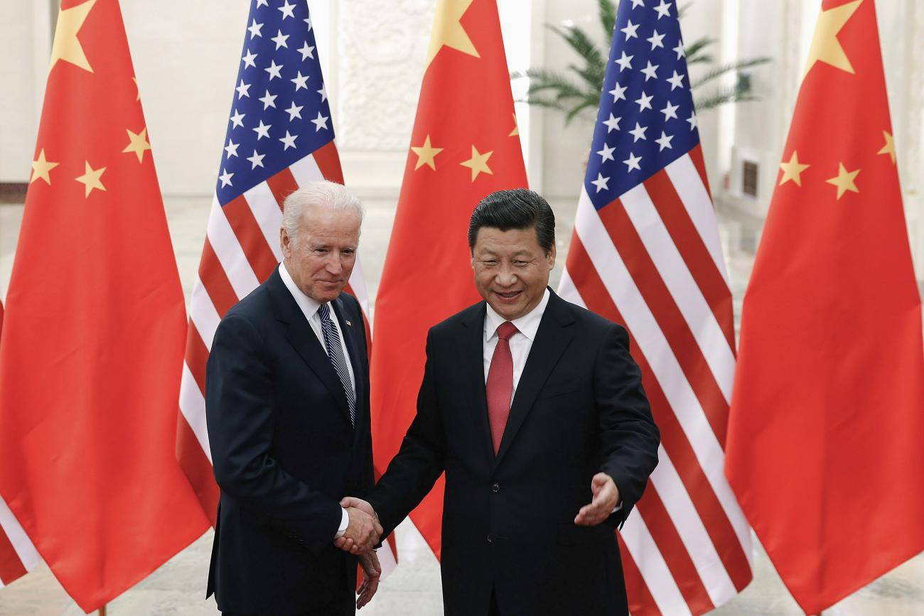 U.S. Vice President Joe Biden (L) shakes hands with Chinese President Xi Jinping ® inside the Great Hall of the People in Beijing, China on December 4, 2013.  REUTERS/Lintao Zhang/Pool