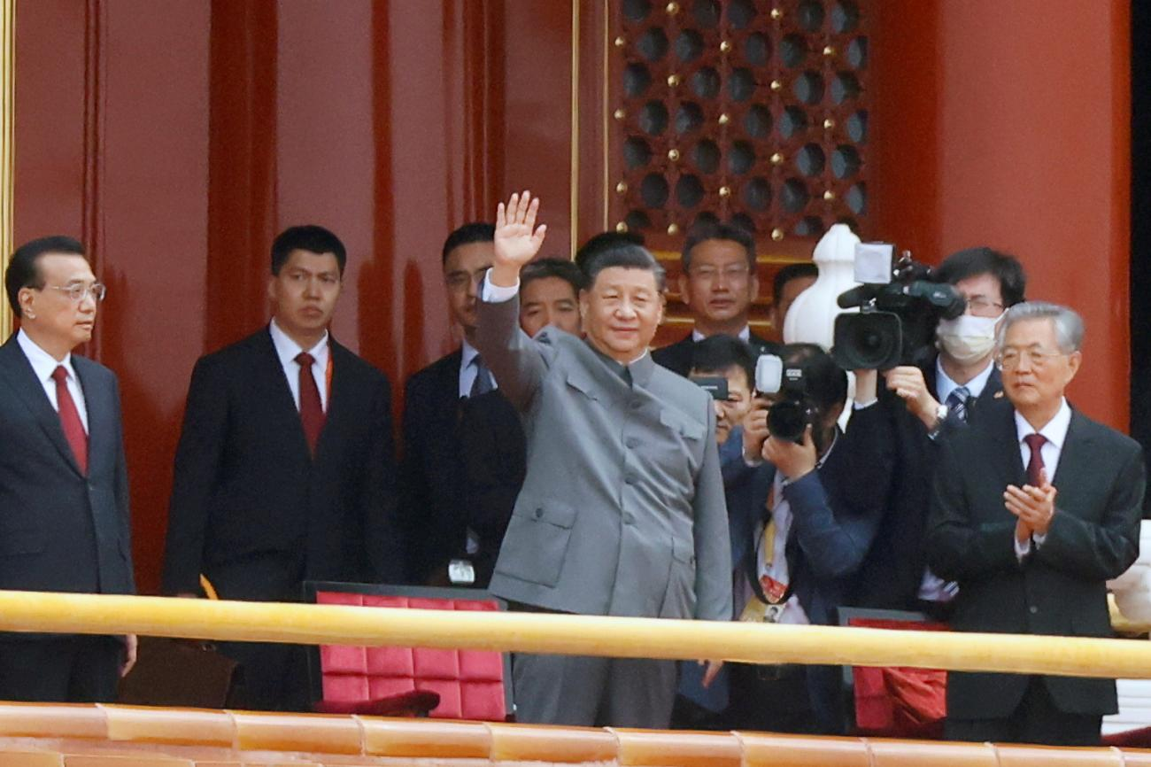 Chinese President Xi Jinping waves next to Premier Li Keqiang and former president Hu Jintao at the 100th founding anniversary of the Communist Party of China, in Tiananmen Square, Beijing, China on July 1, 2021.