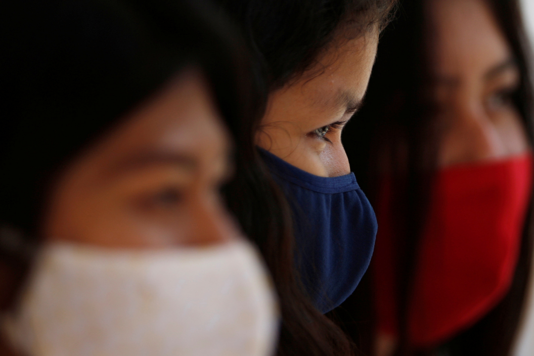 Guajajara women wear protective masks to prevent the spread of COVID at a community school in the village of Morro Branco in Maranhão, a state in northeastern Brazil on October 4, 2020. Photo by Adriano Machado with REUTERS