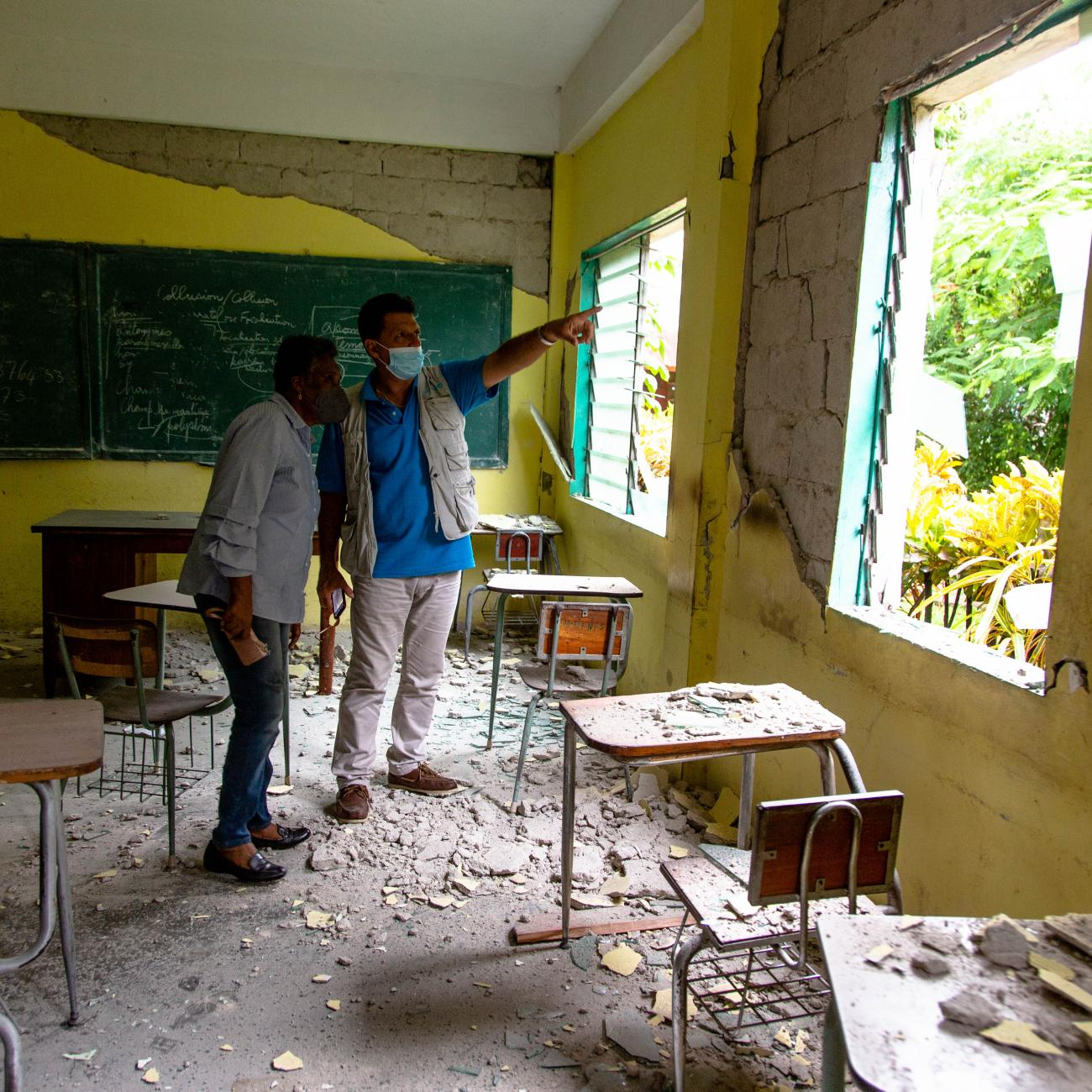 UNICEF's Bruno Maes and Haiti Minister of Education Marie Lucie Joseph tour earthquake damage at the College Mazenod in Camp-Perrin, Les Cayes, Haiti, on August 17, 2021.