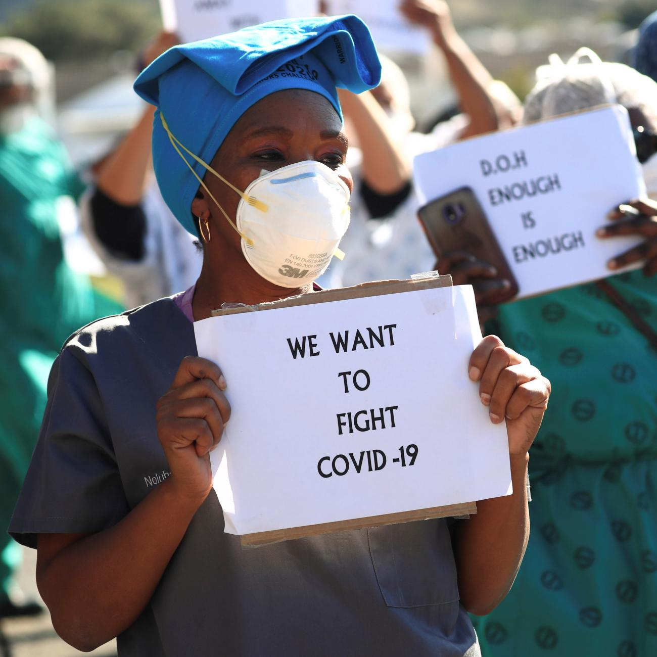 Health care workers holding signs, protest over the lack of personal protective equipment (PPE) during the coronavirus disease (COVID19) outbreak, outside a hospital in Cape Town, South Africa, June 19, 2020