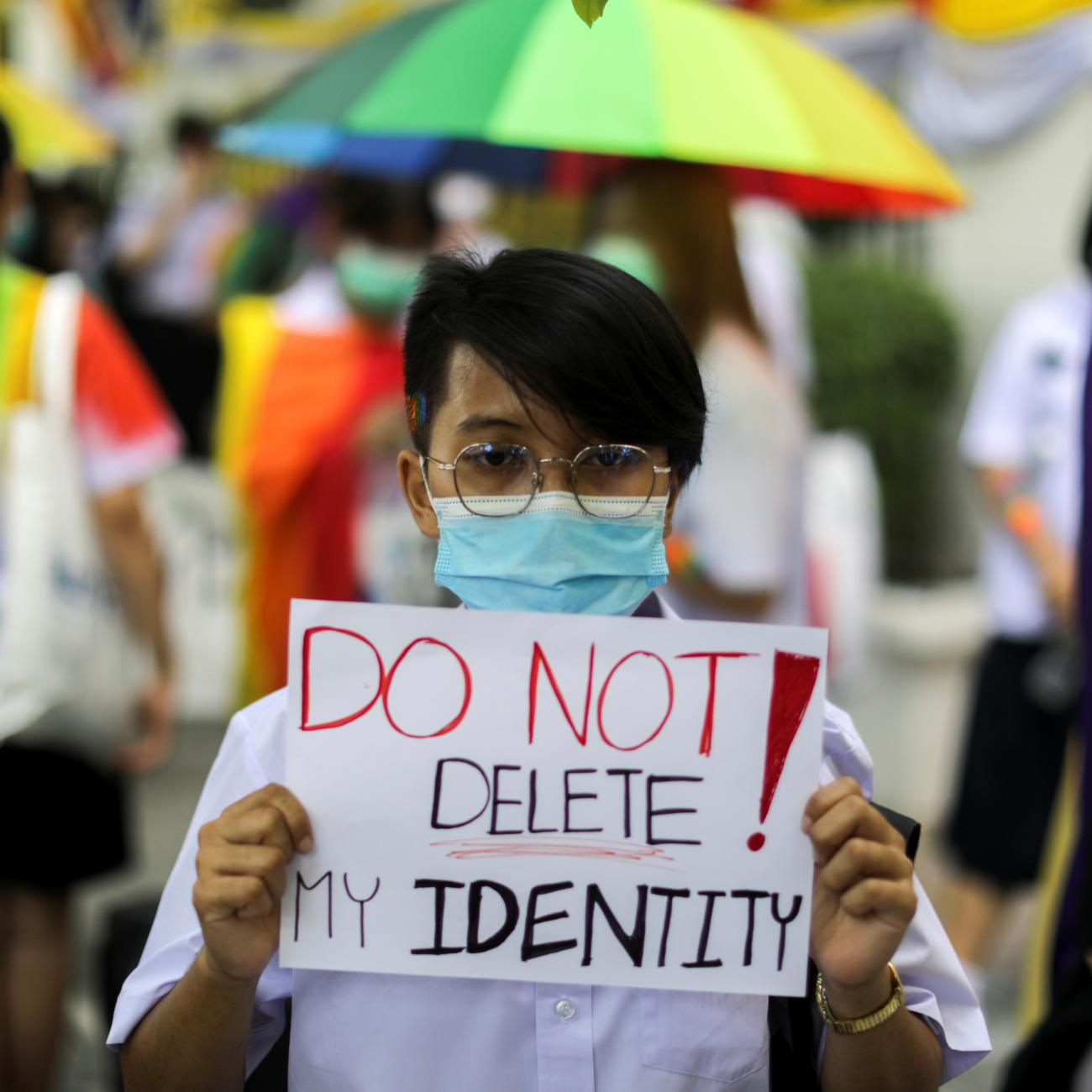 A member of a youth pride student group holds a placard before a rally for gender rights in Bangkok, Thailand, on July 29, 2020.