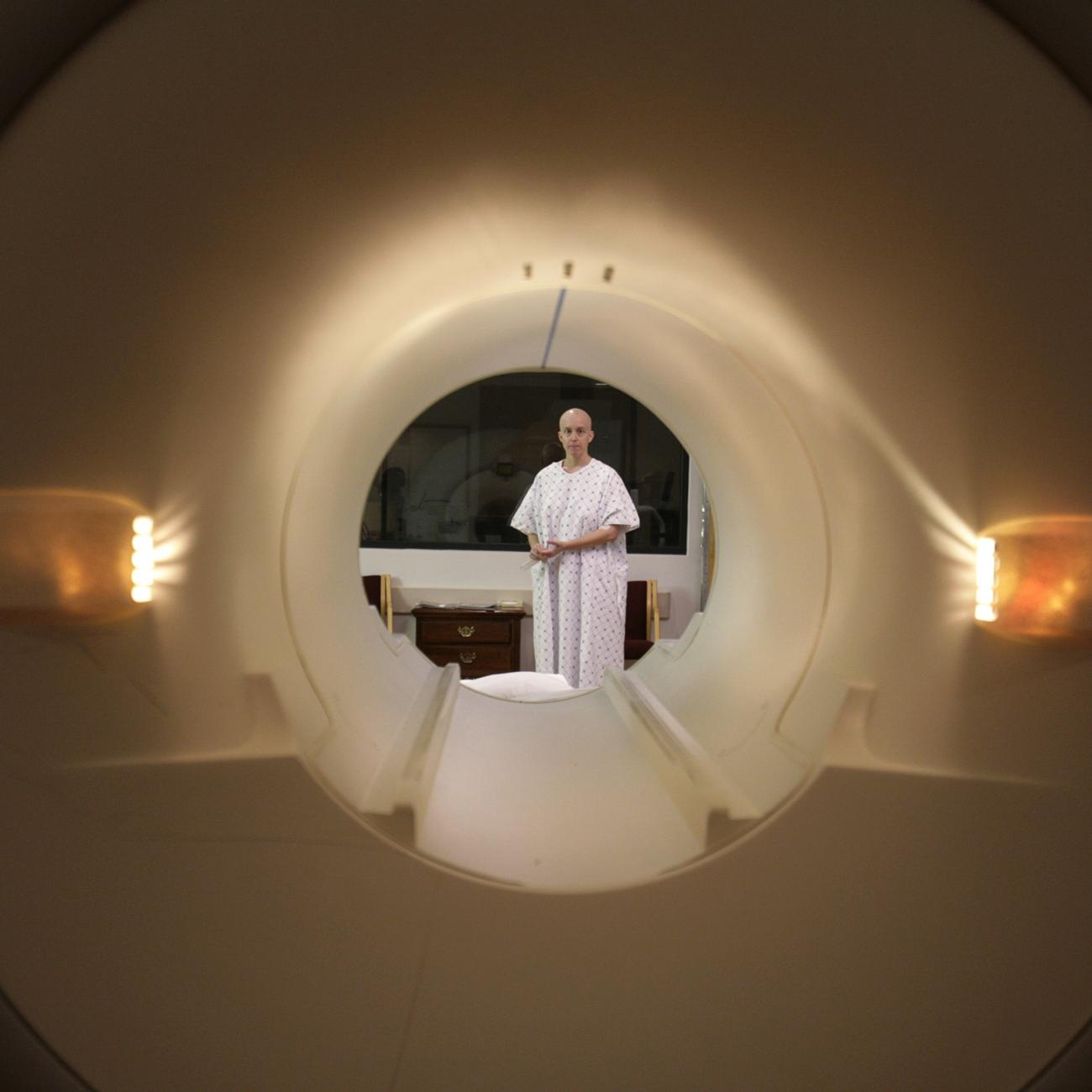 Cancer patient Deborah Charles is seen through the tube of a magnetic resonance imaging scanner as she prepares to enter the MRI machine for an examination at Georgetown University Hospital in Washington May 23, 2007.