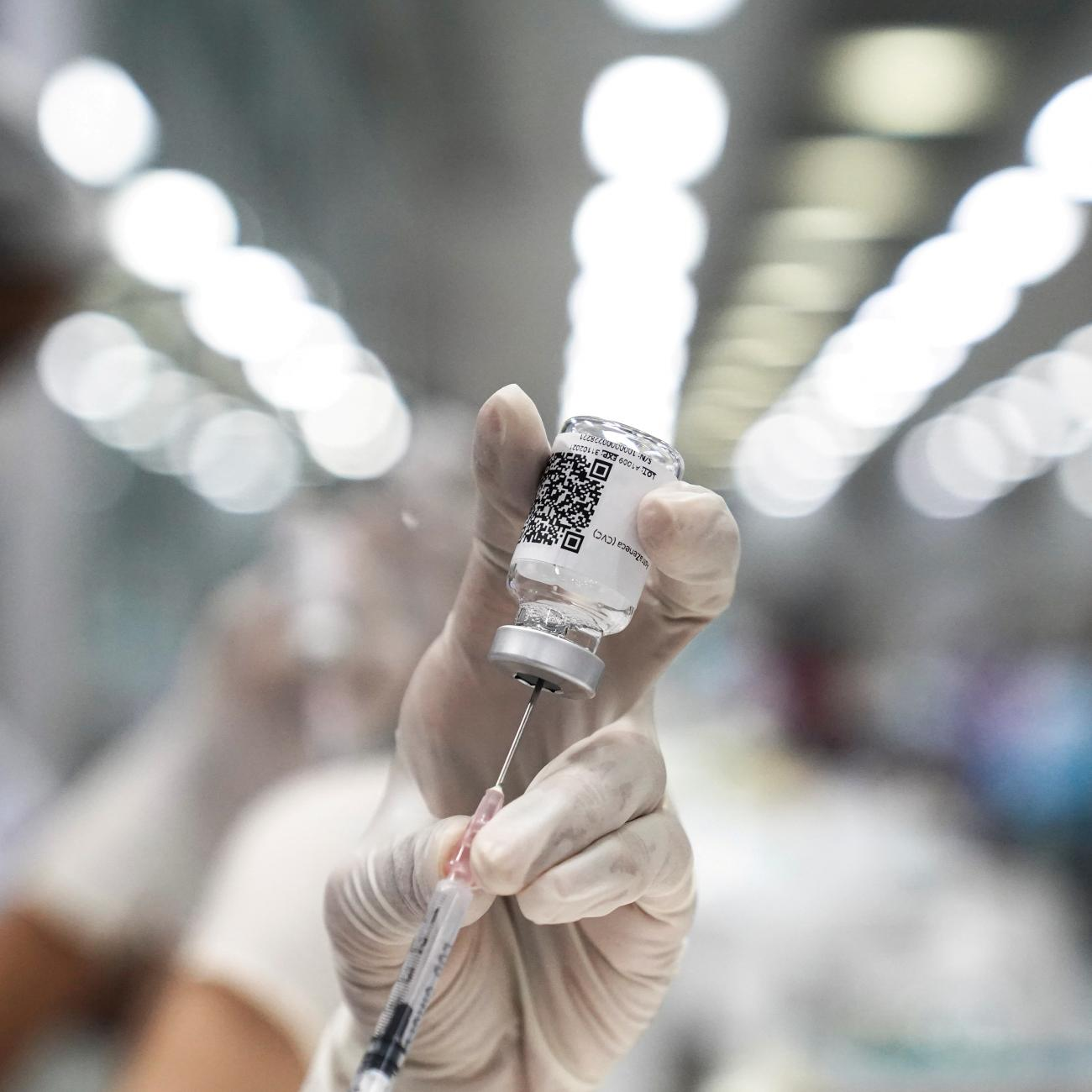 A health worker prepares a dose of AstraZeneca COVID-19 vaccine at the Central Vaccination Center inside the Bang Sue Grand Station (railway station), in Bangkok, Thailand, on June 21, 2021.