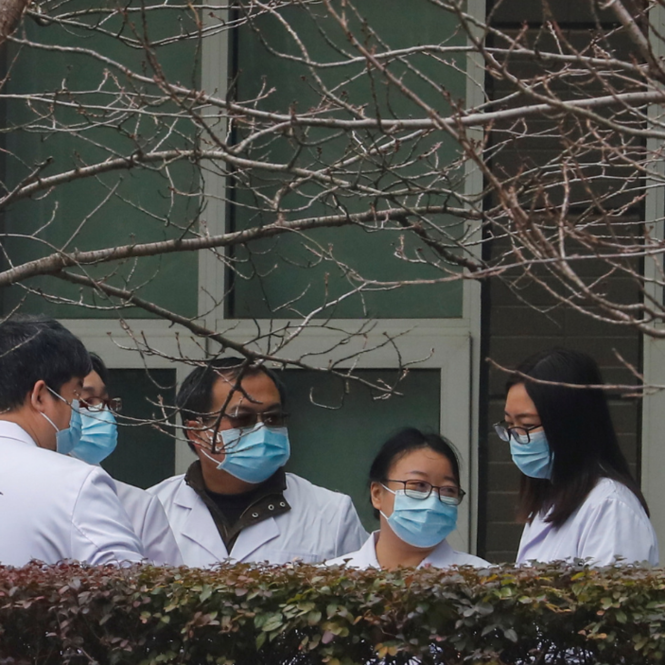 Chinese scientists and officials wait at the Hubei Animal Epidemic Disease Prevention and Control Center during a visit with a World Health Organization (WHO) team investigating the origins of COVID-19, in Wuhan, Hubei province, China, on February 2, 2021.