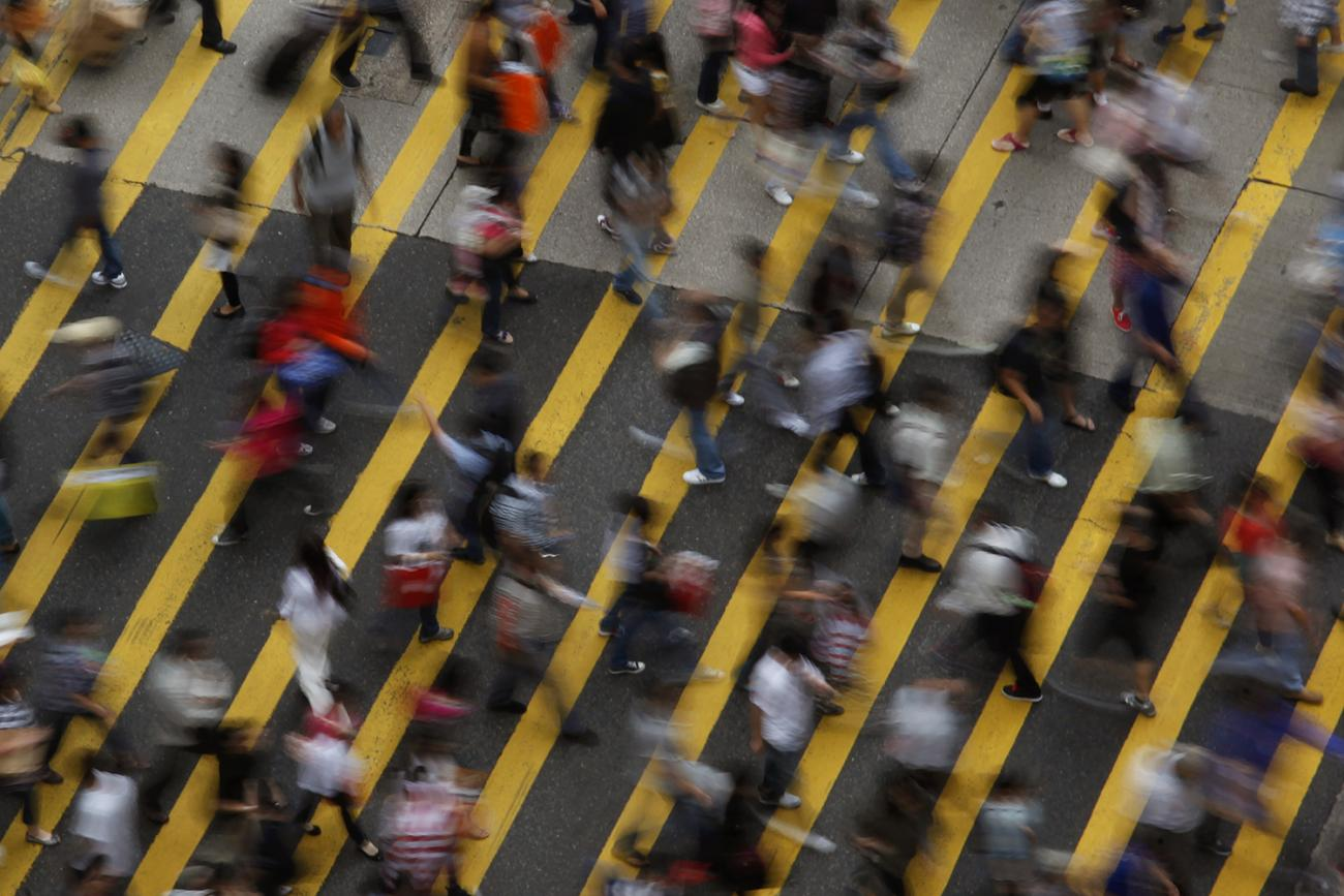 You wouldn't know it from this image of hustle-bustle on the streets of the Mong Kok district in Hong Kong on Oct. 4, 2011, but the workforce in many Asian economic powerhouses is steadily shrinking. Picture shows the street from above, a wide pedestrian walkway with broad yellow lines painted at an angle. Dozens of people can be seen in the frame, all blurred due to fast movement and a slow shutter. REUTERS/Bobby Yip