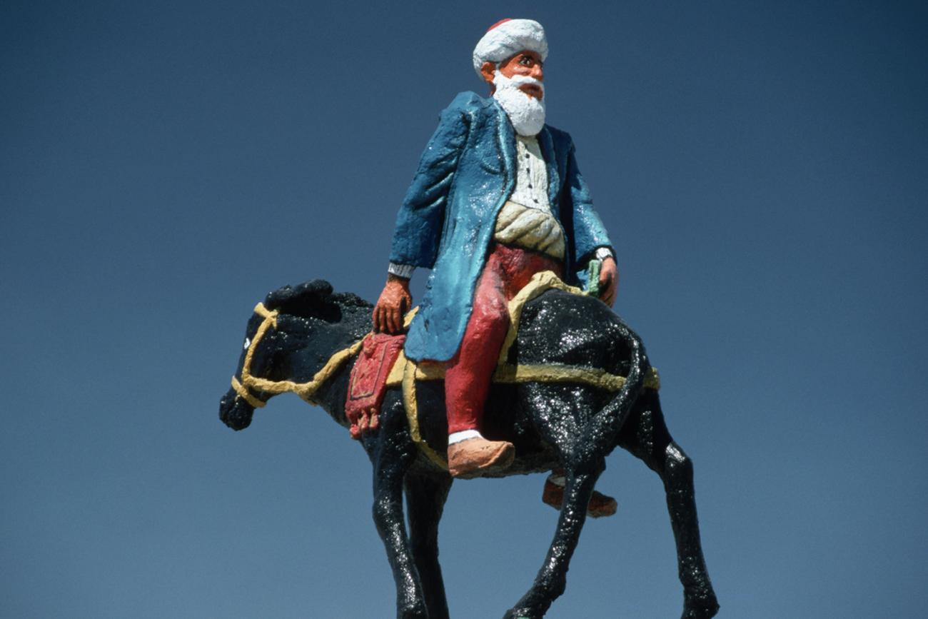 Statue of the Turkish Folkloric Figure Nasreddin Hoca, who looked for his keys in a well-lit place because it was too dark to look for them where they were. Photo shows a statue of the famous figure riding backward on a donkey. GETTY Images/Corbis/Chris Hellier