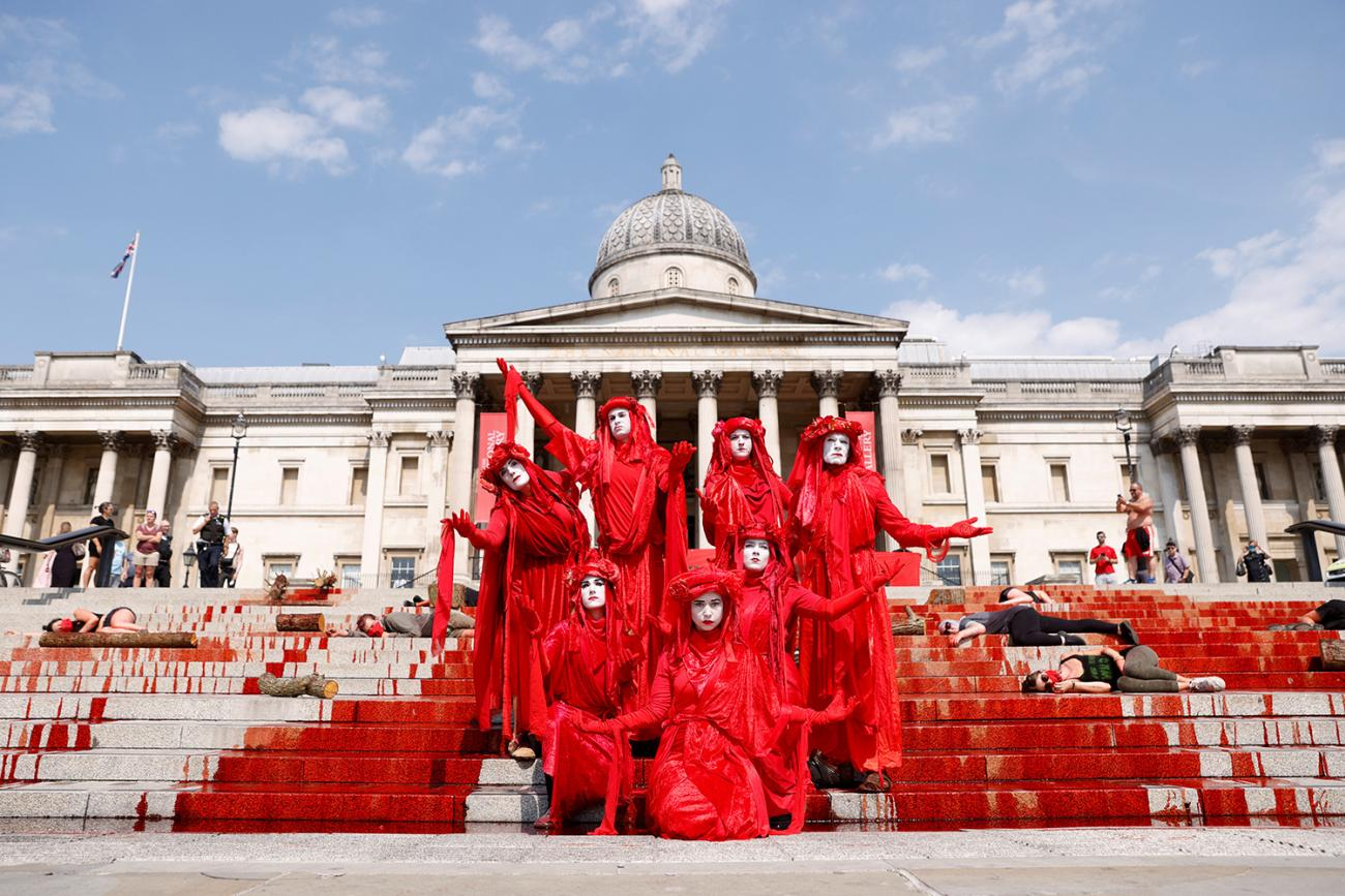 COVID-19 has seen its share of protest and political theater—like one in London on August 9, 2020, to call attention to Brazil, a country also subject to conspiracy theories over the virus' origins. The photo shows a crowd of performance artists demonstrating with costumes and fake blood splashed everywhere. REUTERS/John Sibley