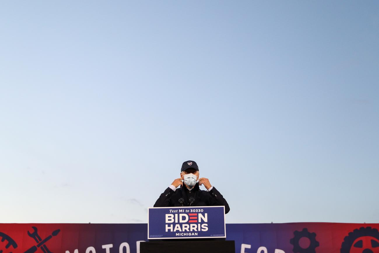 U.S. President-elect Joseph R. Biden prepares to remove his face mask to deliver remarks during a voter mobilization event at the Michigan State Fairgrounds in Novi, Michigan on October 16, 2020.