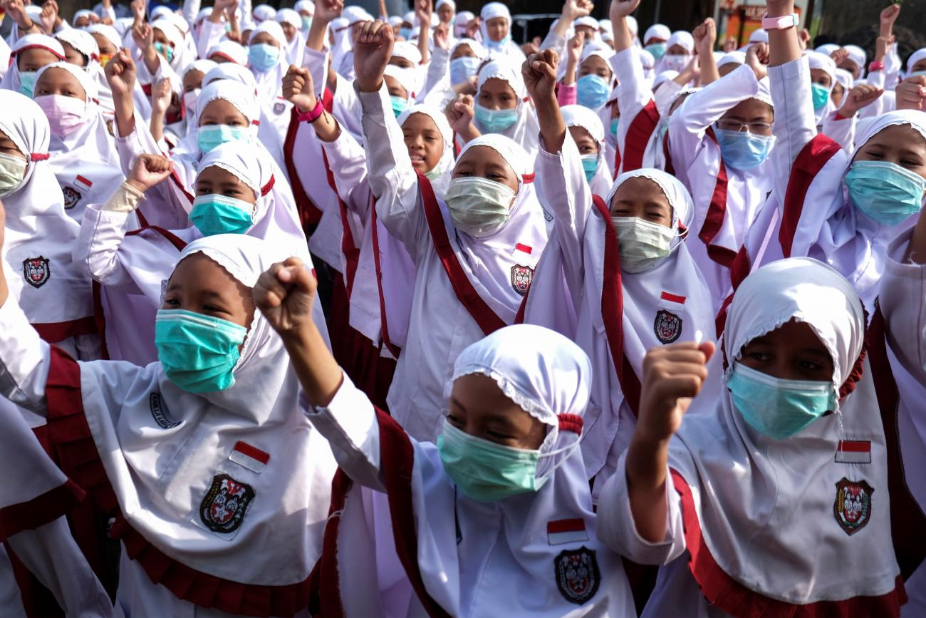 Students wear face masks during a health-care action rally dedicated to COVID-19 in Solo, Central Java, Indonesia on February 3, 2020
