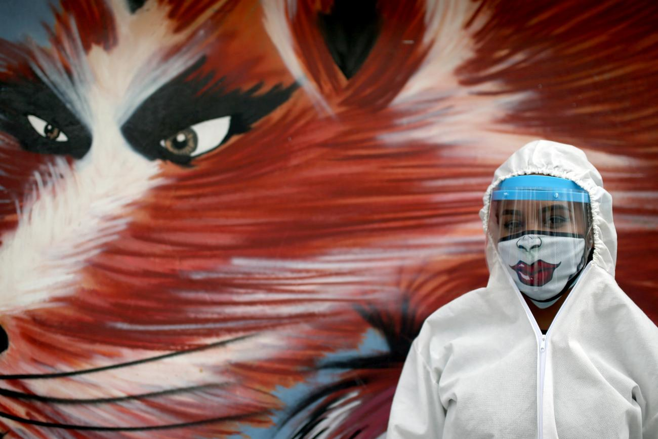 A city employee wearing protective gear poses for a photo during a citywide personal care day, amid the coronavirus disease outbreak in Bogota, Colombia on April 17, 2020.
