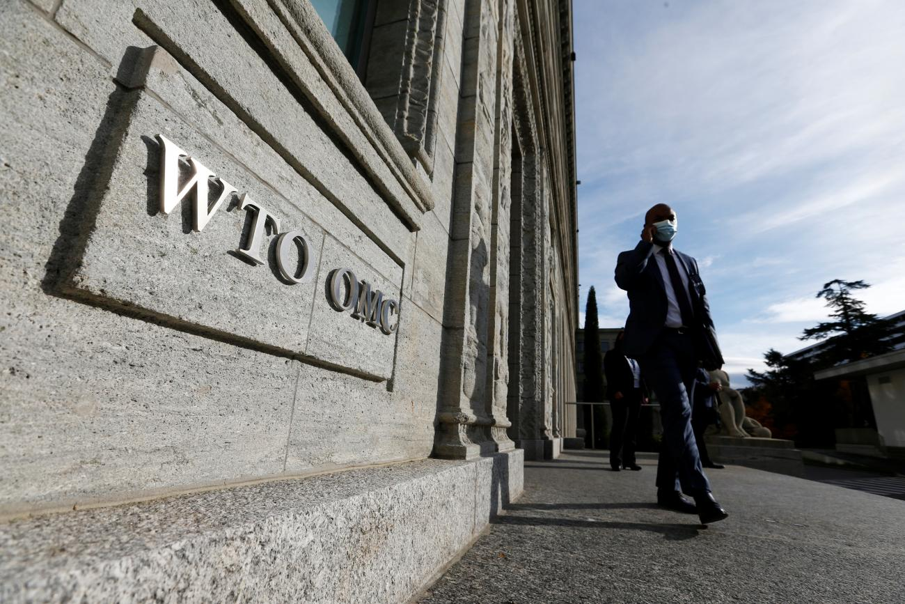 A delegate arrives before a meeting at the World Trade Organization in Geneva, Switzerland on October 28, 2020.