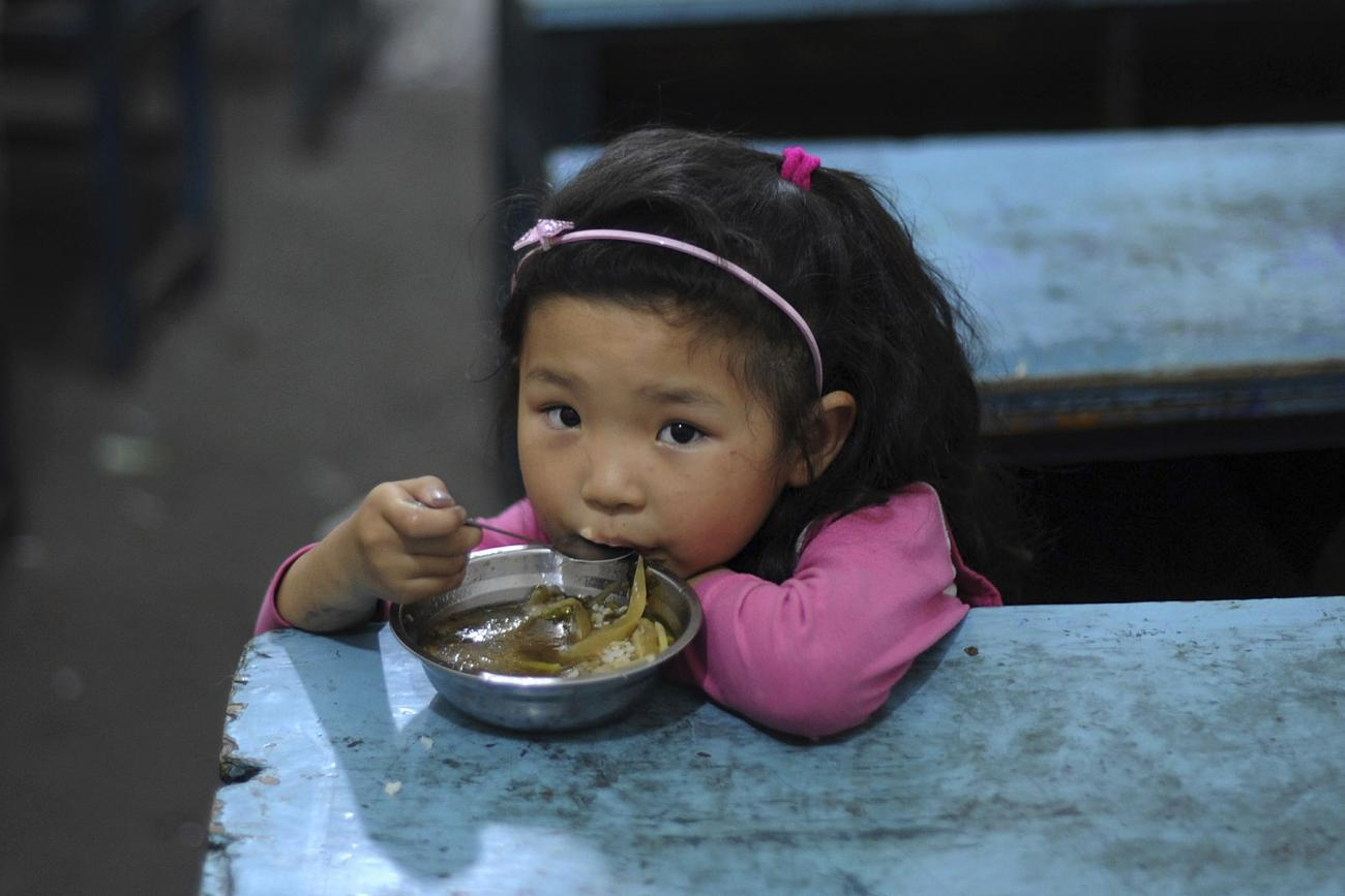 A child eats her lunch in a classroom at a primary school in Hefei, Anhui Province, China on June 1, 2011.