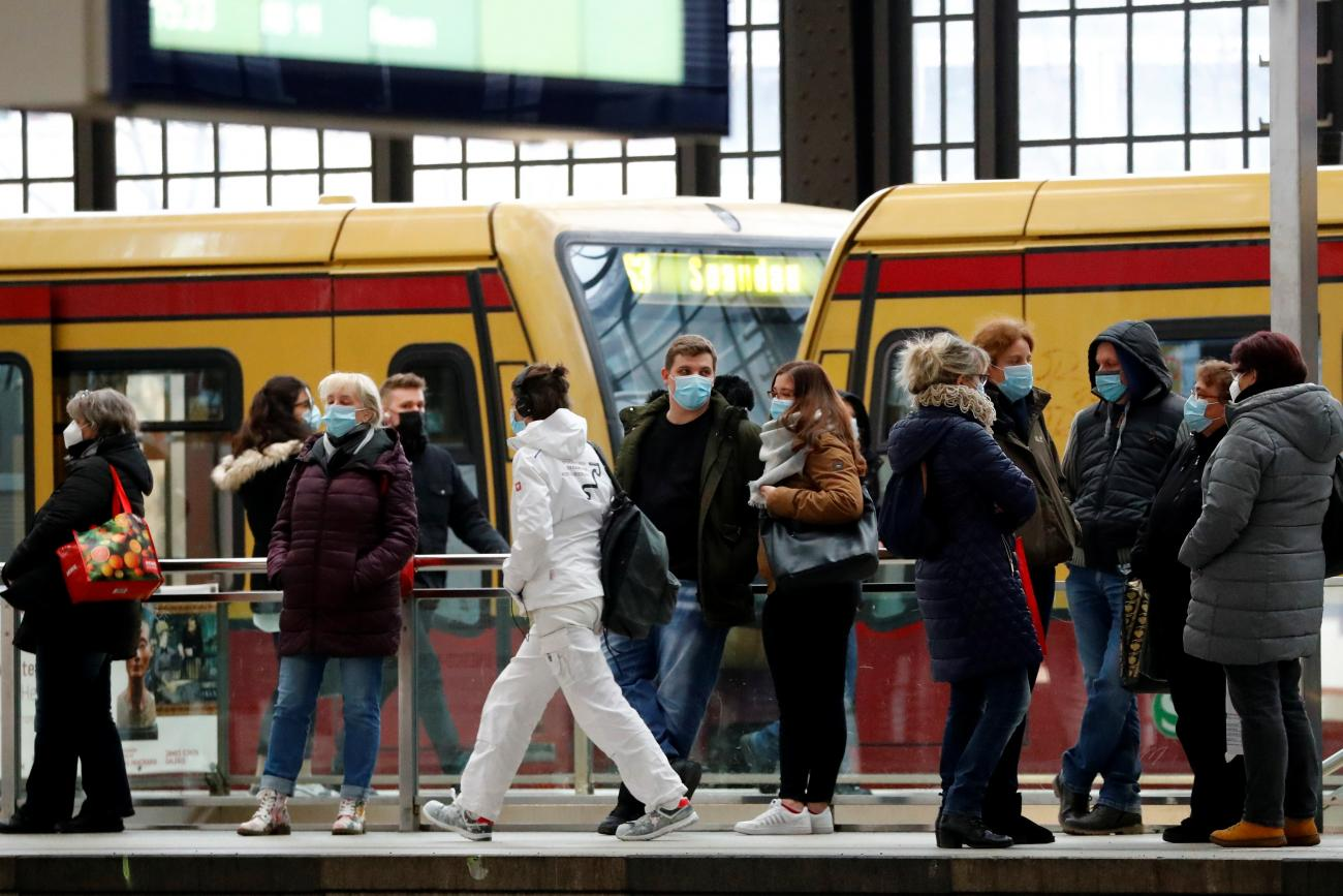 Passengers wear face masks as they wait for an S-Bahn commuter train on the platform at Friedrichstrasse station during lockdown amid the coronavirus pandemic, in Berlin, Germany on February 5, 2021.