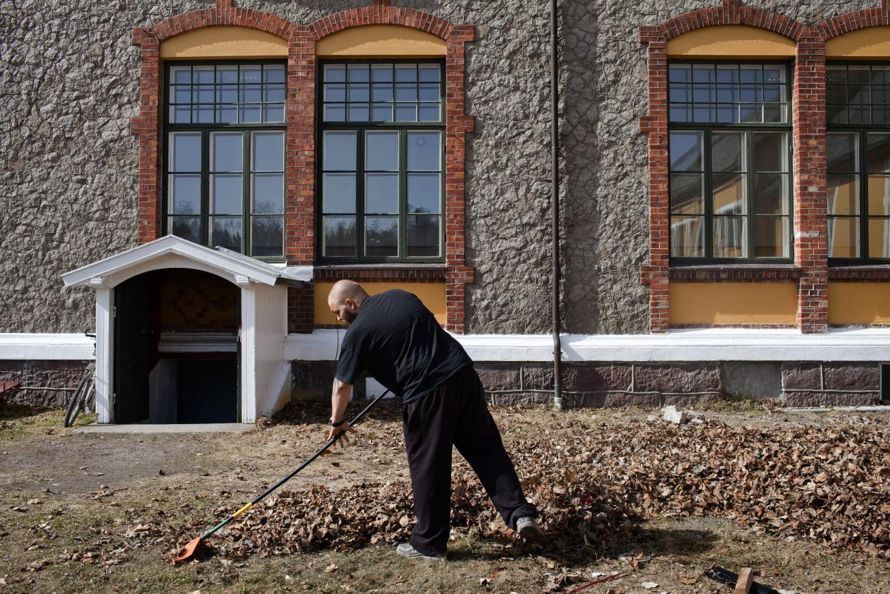An inmate sentenced to ten months rakes leaves in Bastoy Prison in Horten, Norway on April 11, 2011.