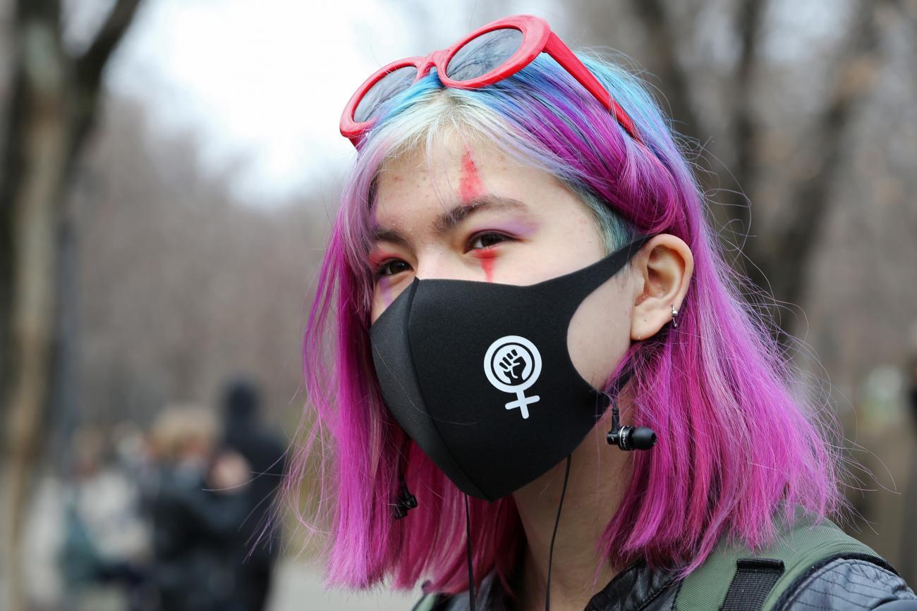 A demonstrator takes part in a march to mark International Women's Day in Almaty, Kazakhstan March 8, 2021.
