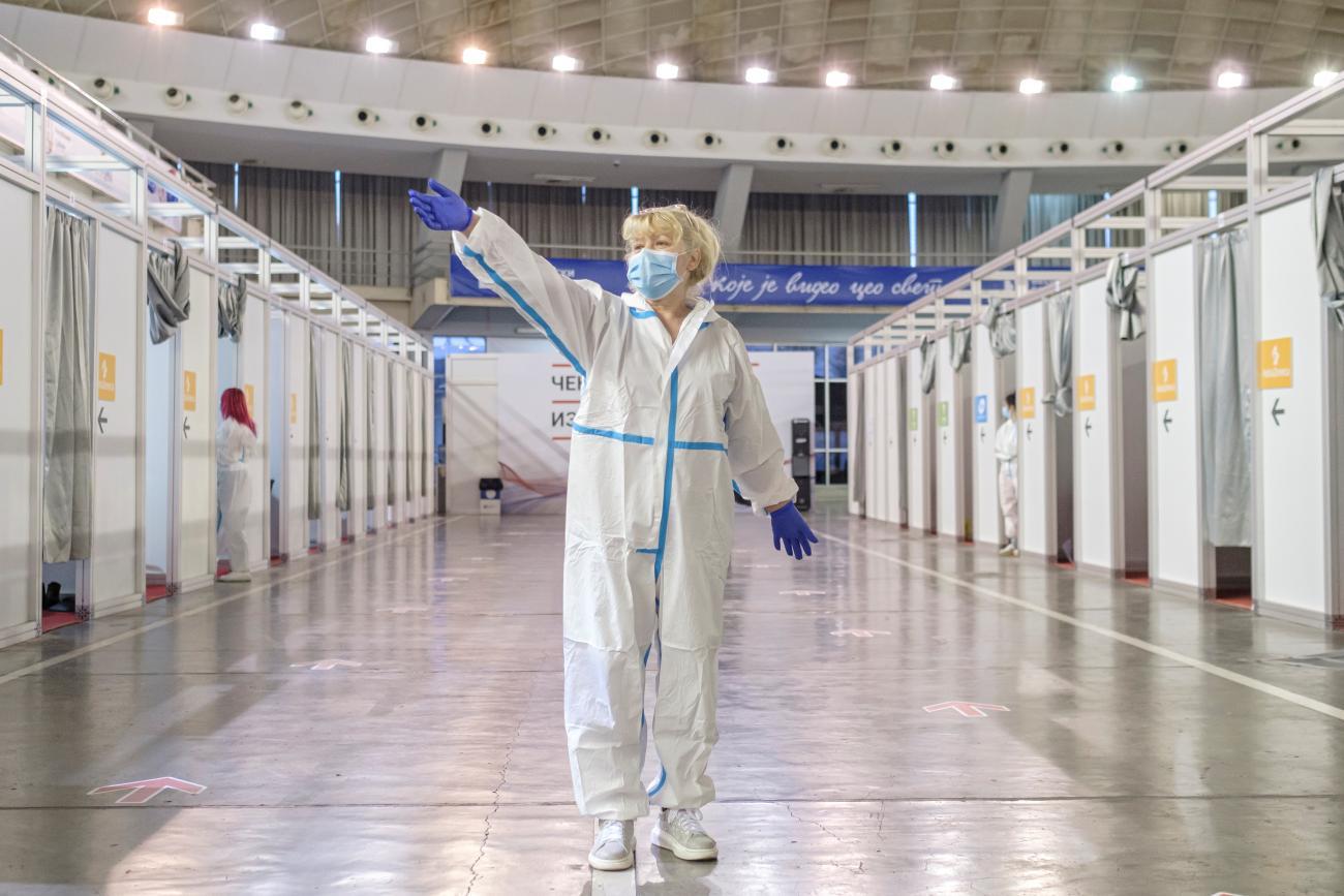 A nurse invites people to the booths to receive AstraZeneca vaccine against the coronavirus disease (COVID-19) in Belgrade, Serbia, March 25, 2021