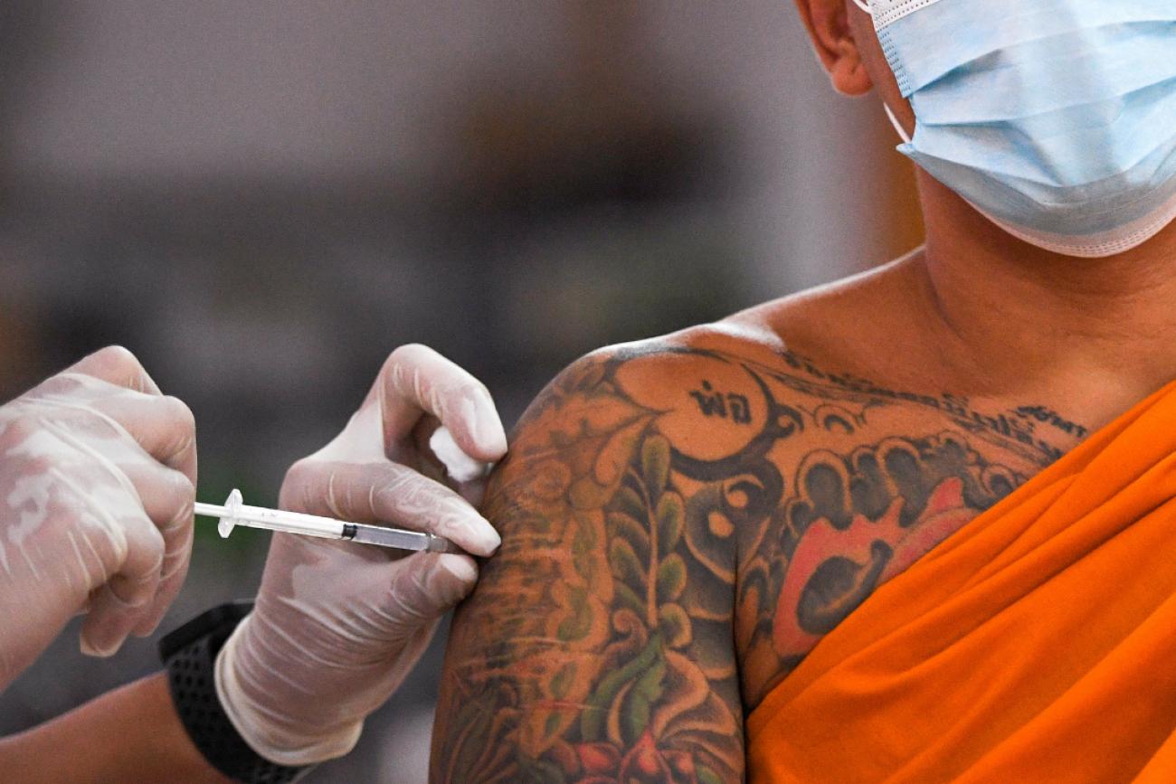 A Buddhist monk receives a Sinovac COVID-19 vaccine in Bangkok, Thailand on April 2, 2021. REUTERS/Chalinee Thirasupa
