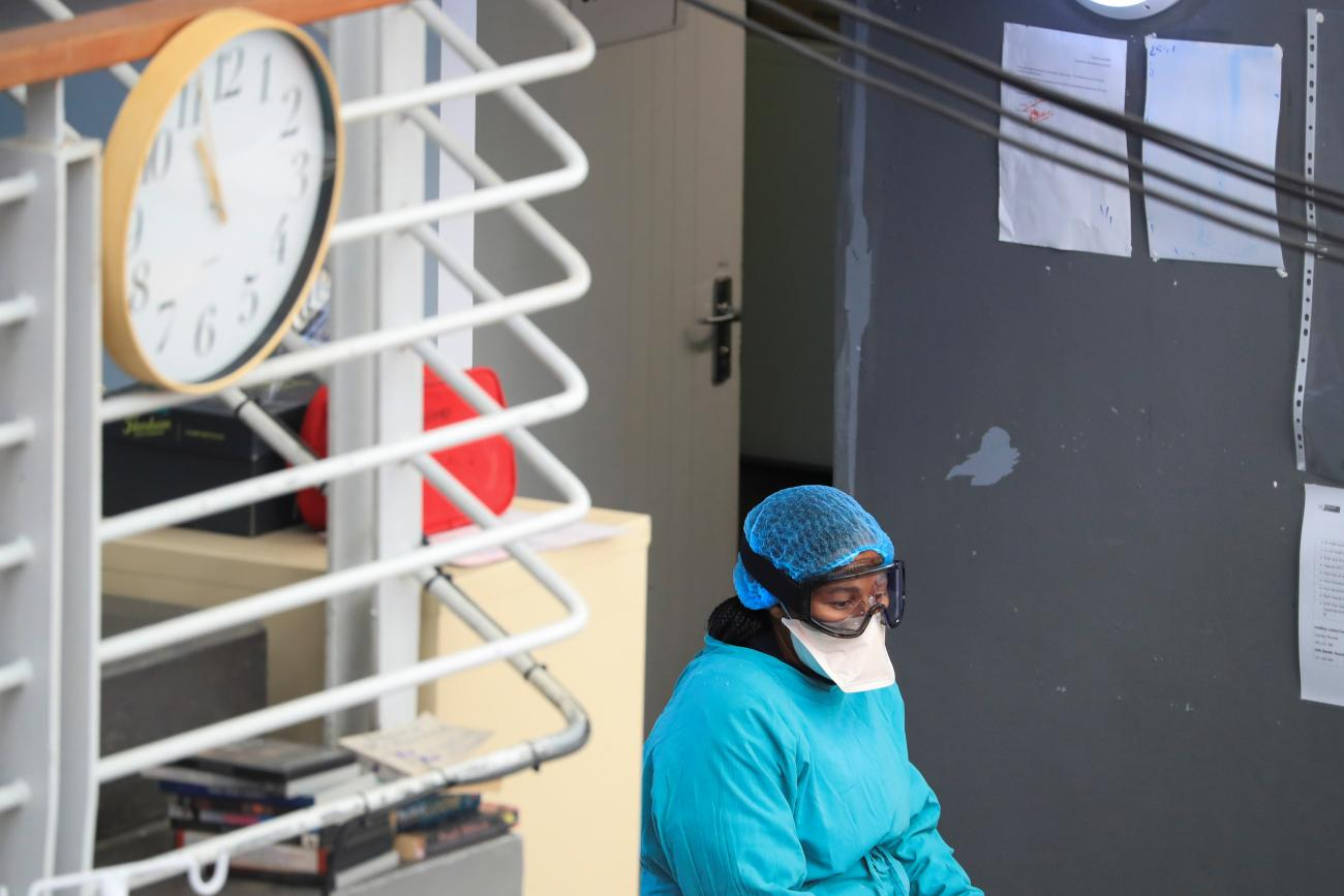 A health worker takes a break at a temporary field hospital set up by Medecins Sans Frontieres (MSF) during the coronavirus pandemic