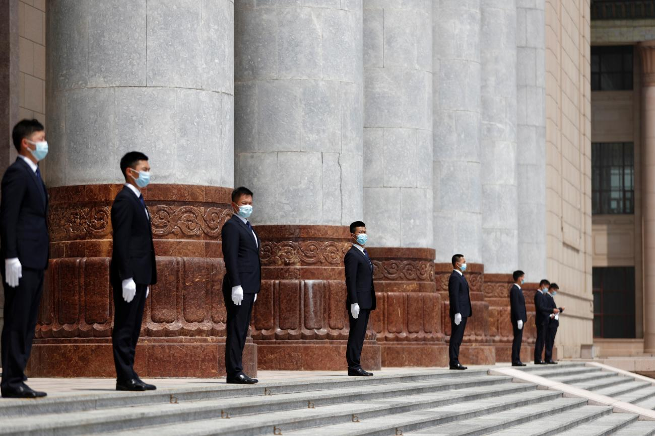 Security personnel wearing face masks following the coronavirus disease (COVID-19) outbreak stand guard outside the Great Hall of the People after the op