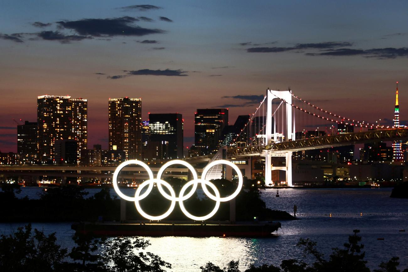 The Olympic Rings are seen in front of the skyline during sunset one night ahead of the official opening of the Tokyo 2020 Olympic Games in Tokyo, Japan, July 22, 2021.