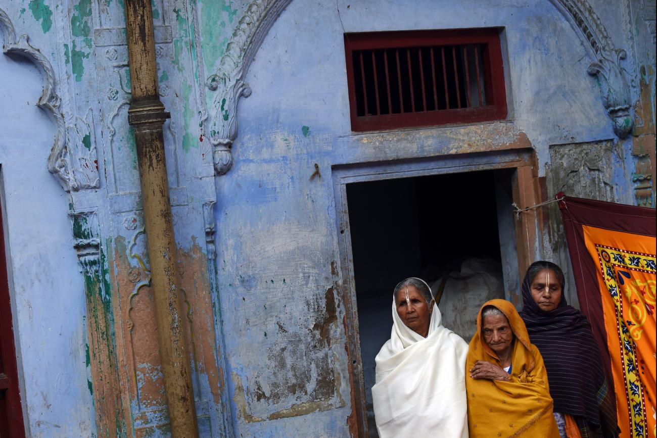 dian widows listen to a talk by Bindeshwar Pathak, founder of NGO Sulabh International which funds some Indian widows sheltering in ashrams in Vindravan on March 3, 2015.