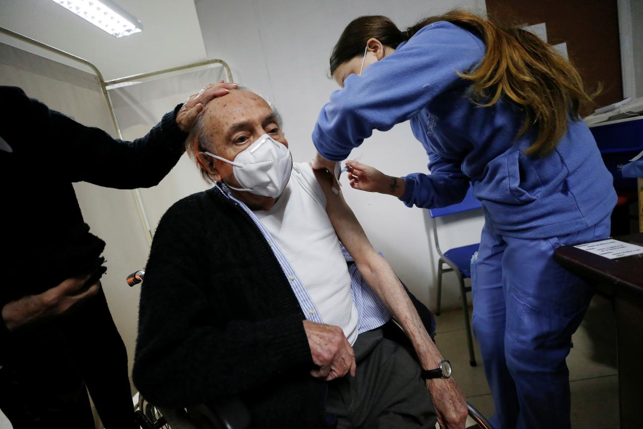 An elderly man receives an AstraZeneca COVID vaccine as Chile starts a booster campaign for those inoculated with the Sinovac vaccine. Photo taken on August 11, 2021.