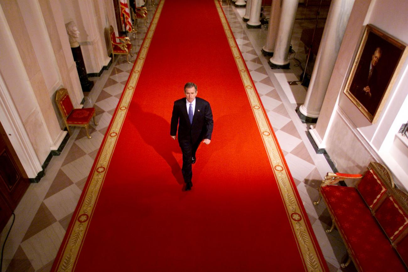 George W Bush walks down the White house halls to the address the nation on the attacks on 9/11