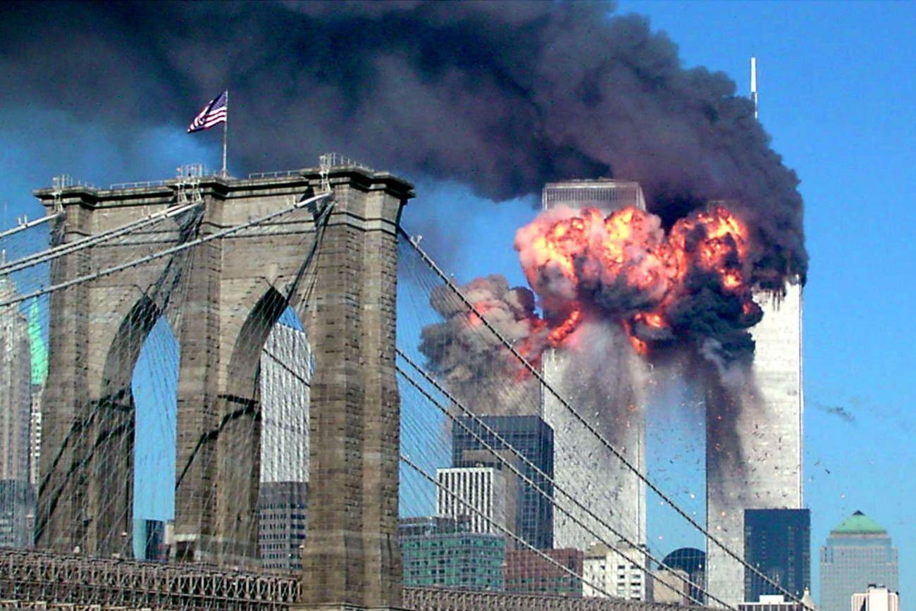 Both towers of the World Trade Center burn after being hit by planes in New York September 11, 2001.