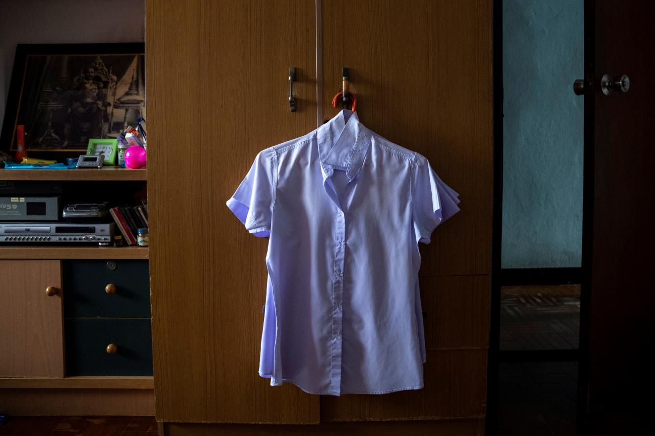 A work uniform hangs in the wardrobe of Nitiwadee Sae-Tia, 50, who took her own life after losing her job during the COVID outbreak in Bangkok, Thailand. Photo taken on May 26, 2020.