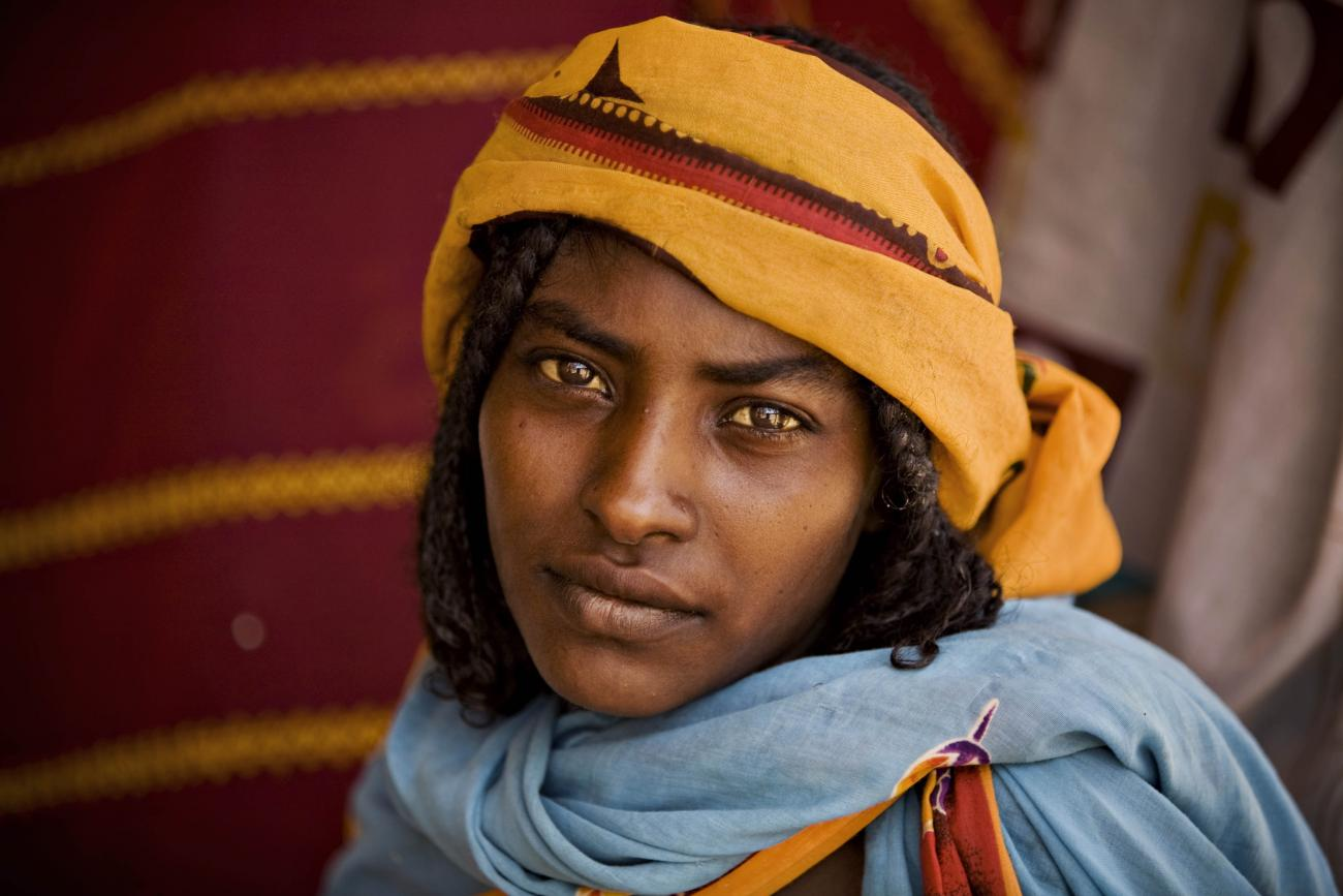 A woman awaits consultation at a health clinic run by the medical charity Médecins Sans Frontières (MSF) Holland in Kerfi, Chad, on June 10, 2008.