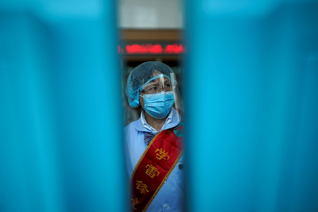 worker wears a mask and a face shield during a government organised media tour at Tongji Hospital following the coronavirus disease (COVID-19) outbreak, in Wuhan, Hubei province, China