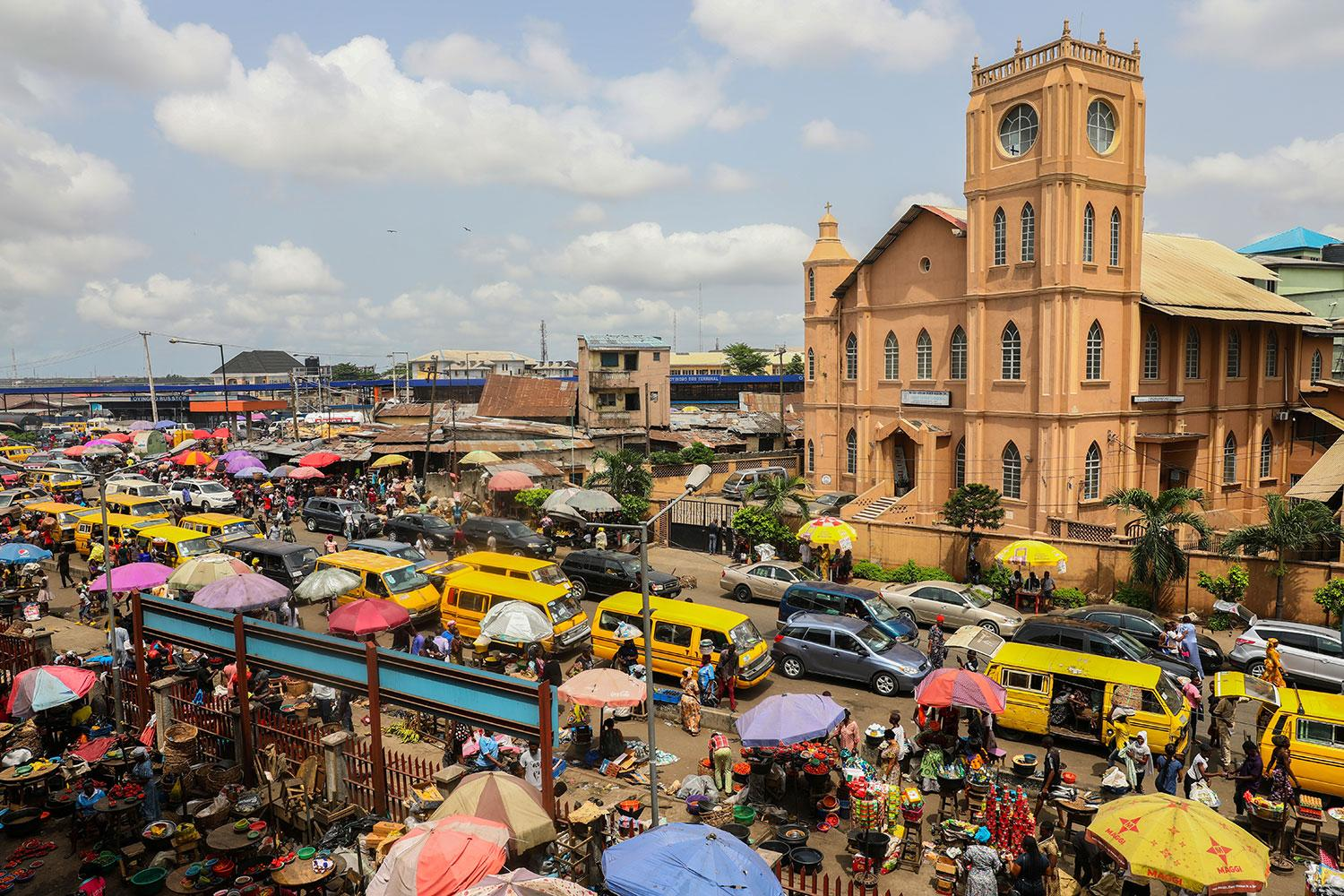 A general view of a food market after Nigeria's President Muhammadu Buhari called for a lockdown starting the same day to limit the spread of coronavirus in Lagos, Nigeria on March 30, 2020. The picture shows a market bustling with trade. REUTERS/Temilade Adelaja