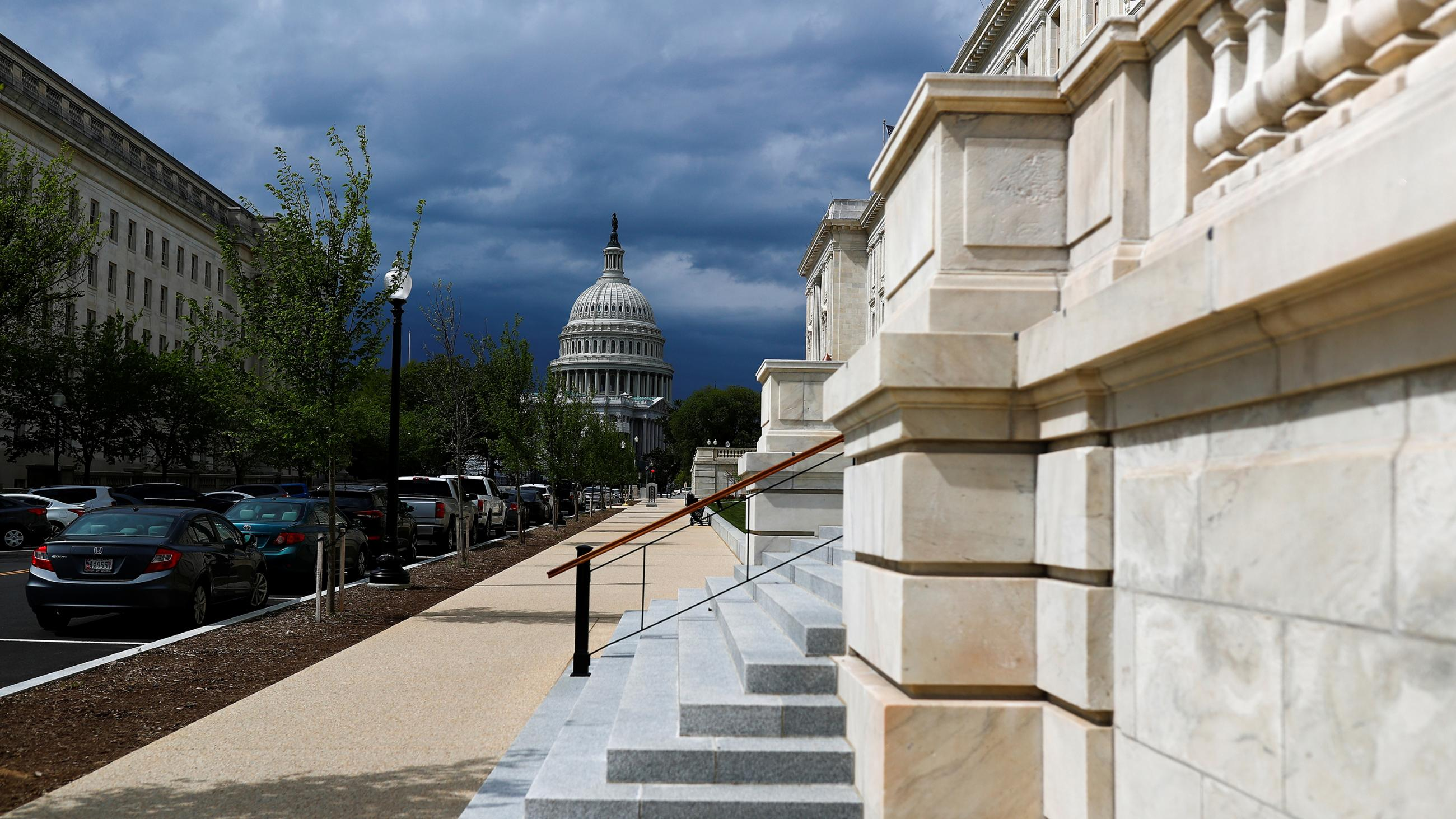 Picture shows the Capitol building from a distance with a set of stone steps in the foreground.