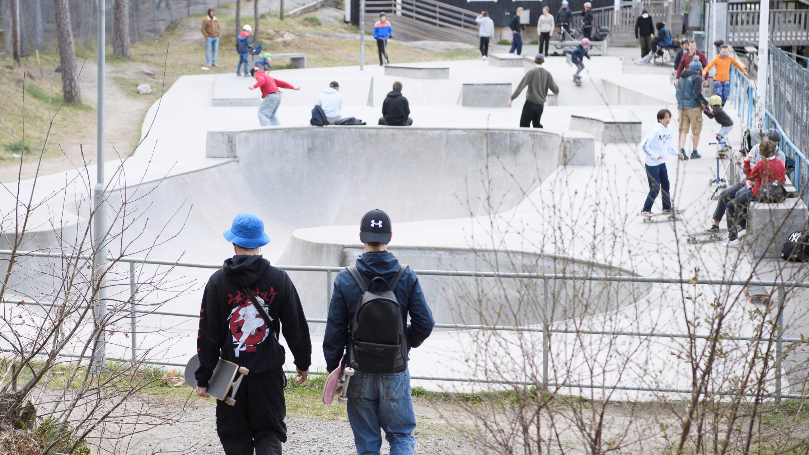 The photo shows a skateboard park that appears to be business as usual.