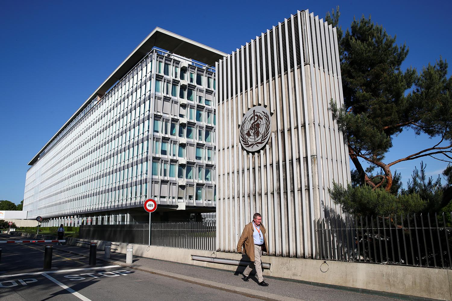 Mike Ryan, Executive Director of the World Health Organization (WHO), walks past the WHO headquarters during the World Health Assembly in Geneva, Switzerland, on May 18, 2020. The photo shows the buildings with the official in front on a brilliant spring day with a clear blue sky. REUTERS/Denis Balibouse